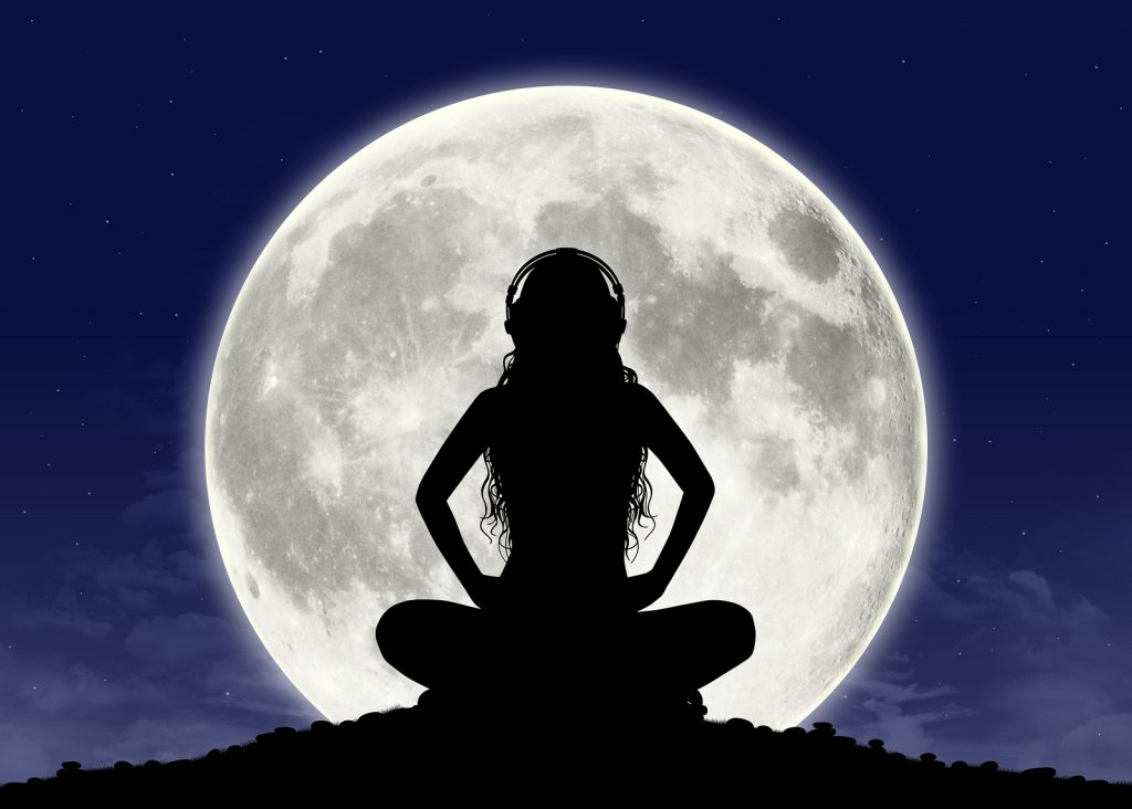 Young Woman Listening To The Music At The Full Moon